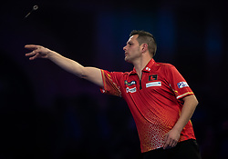 Toni Alcinas during his match against Peter Wright during day four of the William Hill World Darts Championships at Alexandra Palace, London.