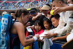 September 23, 2018 - Julia Goerges of Germany signs autographs after winning her first-round match at the 2018 Dongfeng Motor Wuhan Open WTA Premier 5 tennis tournament (Credit Image: © AFP7 via ZUMA Wire)