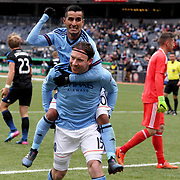 NEW YORK, NEW YORK - April 12: Thomas McNamara #15 of New York City FC celebrates with team mate Maximiliano Moralez #10 of New York City FC on his back after scoring the winning goal in his sides 2-1 win during the New York City FC Vs San Jose Earthquakes regular season MLS game at Yankee Stadium on April 1, 2017 in New York City. (Photo by Tim Clayton/Corbis via Getty Images)