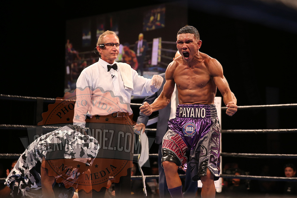 WINTER PARK, FL - AUGUST 02: Juan Carlos Payano (R) celebrates his victory over Rau'shee Warren after the Premier Boxing Champions on Bounce TV boxing match at Full Sail University - Ebbs Auditorium on August 2, 2015 in Winter Park, Florida. Payano won the bout and retained his WBA and IBO  bantamweight title. (Photo by Alex Menendez/Getty Images) *** Local Caption *** Juan Carlos Payano; Rau'shee Warren