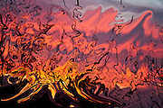 abstract fire in the sky, red and yellow fluid shapes with many shades