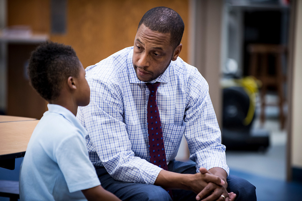 Eric Bethel, principal at Turner Elementary School in Washington, D.C., speaks to a student after breaking up a scuffle between him and a good friend during lunch period on May 4, 2017.