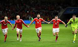 Aaron Ramsey, Jonathan Williams, Joe Ledley, Gareth Bale and Wayne Hennessey of Wales celebrate with the Wales fans after the game  - Mandatory by-line: Joe Meredith/JMP - 01/07/2016 - FOOTBALL - Stade Pierre Mauroy - Lille, France - Wales v Belgium - UEFA European Championship quarter final