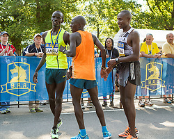 Boston Athletic Association 10K road race: top men Sambu, Salel and Mutai congratulate each other after finsih