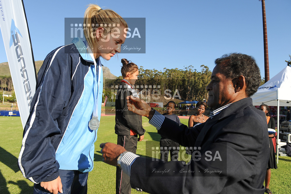 STELLENBOSCH, South Africa - Saturday 13 April 2013, Anuscha Nice receives her medal from Mr Vivian Gungaram during day 2 of the South African Senior Athletics championships at the University of Stellenbosch's Coetzenburg stadium.Photo by Roger Sedres/ ImageSA