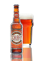 A bottle of Schlafly Pale Ale with condensation and a pint glass of beer behind it.