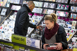 © Licensed to London News Pictures. 15/01/2013. London, UK. Shoppers are seen inside HMV in Oxford Street, London, today (15/01/13) after the retailer went in to administration. Photo credit: Matt Cetti-Roberts/LNP
