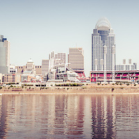Cincinnati skyline retro panorama photo of downtown city buildings including Great American Ballpark, Great American Insurance Group Tower, PNC Tower building, Omnicare building, US Bank building, Carew Tower building, and Scripps Center building. Photo was taken in July 2012. Panoramic ratio is 1:3.