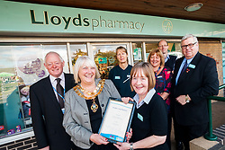 Lloyds Pharmacy Stocksbridge has achieved the status of 'Healthy Living Pharmacy'. A special accreditation for offering high levels of health screening  and advice to the local community. Pharmacy Manager Jackie Walter receiving the award from Mayor of Stocksbridge Susie Abrahams, also pictured left to right are NHS Sheffield Commissioning Manager Gareth Johnstone, Lloyds Stcksbridge Healthy Living Champion Vikki Sheppard, Valley Medical Centre Practace Manager Liz Sedgwick Dr Peter Moulsher GP and Lloyds Area Manager Greg Campbell<br /> <br /> <br /> <br /> 04 October 2012<br /> Image © Paul David Drabble
