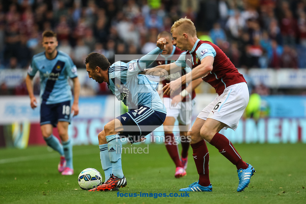 Ben Mee of Burnley and Morgan Amalfitano of West Ham United compete for the ball during the Barclays Premier League match at Turf Moor, Burnley<br /> Picture by Daniel Chesterton/Focus Images Ltd +44 7966 018899<br /> 18/10/2014