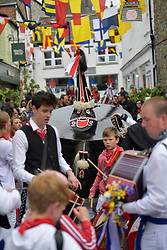 © Licensed to London News Pictures. 01/05/2017 May Day celebrations in Padstow Cornwall. The Kids Oss. The Blue Oss and the Red Osds lead the traditional May Day celebrations around the historic harbour of Padstow in Cornwall.<br /> Despite the rain large crowds attended the annual event.Photo credit : MARK HEMSWORTH/LNP
