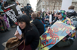 ©  London News Pictures. 14/03/2012. London, UK.  Students and union members take part in a sit down protest outside Downing Street during a protest march in London on March 14th, 2012 to demonstrate against the growing cost of higher education. The walkout demonstration is part of a week of action to show high tuition fees, hidden course costs and a lack of bursaries are pricing students out of education. Photo credit : Ben Cawthra/LNP