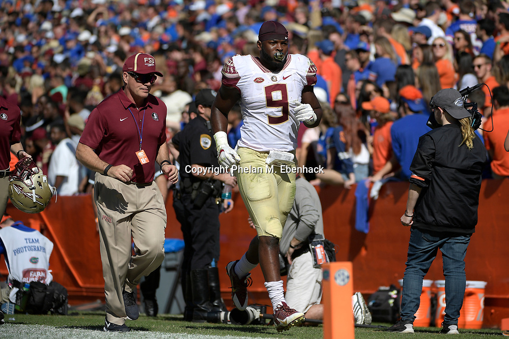 Florida State running back Jacques Patrick (9) heads to the locker room during the first half of an NCAA college football game against Florida Saturday, Nov. 25, 2017, in Gainesville, Fla. (Photo by Phelan M. Ebenhack)