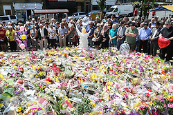 © Licensed to London News Pictures. 23/06/2016. Birstall, UK. Mourners gather in Birstall, West Yorkshire, a week to the day that Labour MP was shot and killed in the town. A one minutes silence was held at 13.50, the time that Jo was attacked last week outside her constituency surgery . Photo credit : Ian Hinchliffe/LNP