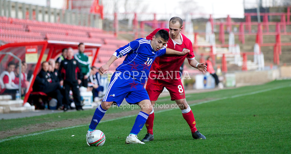 WREXHAM, WALES - Wednesday, February 29, 2012: Wales' Jake Howells (Luton Town) and Andorra's Cristopher Pousa (FC Santa Coloma) during the UEFA Under-21 Championship Qualifying Group 3 match at the Racecourse Ground. (Pic by Vegard Grott/Propaganda)