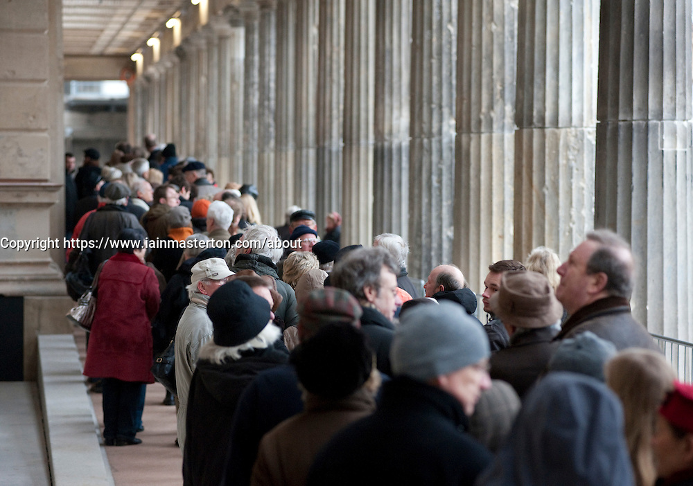 Crowds of people queue to visit the newly renovated Neues Museum on the Museuminsel in central Berlin reopened after many years construction work Architect David Chipperfield March 2009