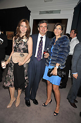 Left to right, DEMITRI & ELIZABETH HORNE and PAOLA PAVLOV at a party to celebrate the publication of Elena Makri Liberis's book 'Every Month, Same day' held at Sotheby's, 34-35 New Bond Street, London on 5th May 2009.