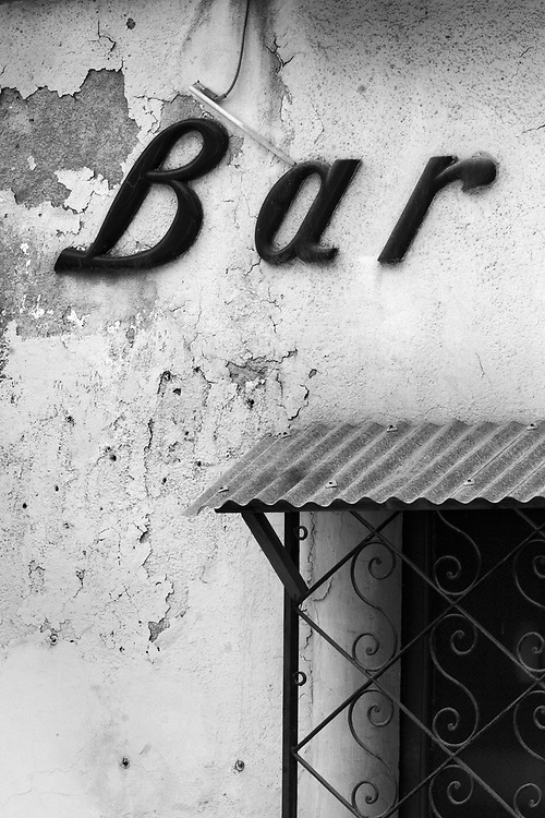 Black and white photography old bar sign in torino italy by karl r lilliendahl photographer