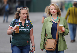 Two fans walk into the Twickenham Stadium. - Photo mandatory by-line: Alex James/JMP - 07966 386802 - 06/09/2014 - SPORT - RUGBY UNION - London, England - Twickenham Stadium - Saracens v Wasps - Aviva Premiership London Double Header.