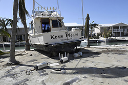 The Keys Please boat sits on the seawall along a canal in a community on Cudjoe Key, FL, USA, on Tuesday, September 12, 2017. The boat originally was moored to the dock inside the canal, but the force of Hurricane Irma pushed the boat on land. Photo by Taimy Alvarez/Sun Sentinel/TNS/ABACAPRESS.COM