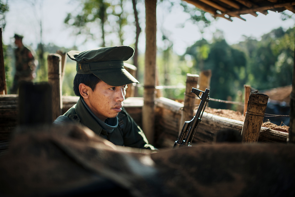 KIA Mobile Brigade, Myanmar 20180123 <br /> A KIA soldier watching the outer defences of one of the KIA Mobile Brigade outposts, just 1 km away form the closest Burma Army outpost.<br /> Photo: Vilhelm Stokstad / Kontinent