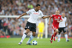 LONDON, ENGLAND - Monday, May 9, 2011: Fulham's Moussa Dembele in action against Liverpool during the Premiership match at Craven Cottage. (Photo by David Rawcliffe/Propaganda)