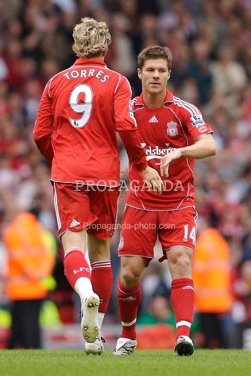 Liverpool, England - Saturday, September 1, 2007: Liverpool's Fernando Torres celebrates scoring the third goal against Derby County, with his team-mate Xabi Alonso during the Premiership match at Anfield. (Photo by David Rawcliffe/Propaganda)