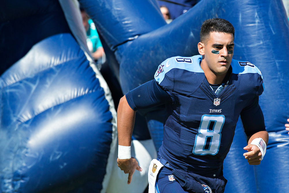 NASHVILLE, TN - OCTOBER 18:  Marcus Mariota #8 of the Tennessee Titans runs onto the field before a game against the Miami Dolphins at LP Field on October 18, 2015 in Nashville, Tennessee.  The Dolphins defeated the Titans 38-10.  (Photo by Wesley Hitt/Getty Images) *** Local Caption *** Marcus Mariota
