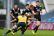 New Zealand's Hapakuki Moala-Liva'a is held in the tackle by Australia No.8 Maclean Jones during the World Rugby U20 Championship 5rd Place play-off  match Australia U20 -V- New Zealand U20 at The AJ Bell Stadium, Salford, Greater Manchester, England on Saturday, June  25  2016.(Steve Flynn/Image of Sport)