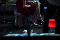 A young woman sits at the nightclub Pacha in Marrakech, Morocco on May 9, 2009.