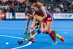 Lily Owsley of Great Britain Women is watched by Zixia Ou of China Women during the 2019 Women's FIH Pro League match at Lee Valley Hockey Centre, Stratford<br /> Picture by Simon Parker/Focus Images Ltd <br /> 03/05/2019