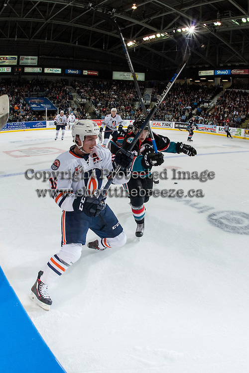 KELOWNA, CANADA - SEPTEMBER 24: Kyle Topping #24 of the Kelowna Rockets checks Nick Chyzowski #16 of the Kamloops Blazers on September 24, 2016 at Prospera Place in Kelowna, British Columbia, Canada.  (Photo by Marissa Baecker/Shoot the Breeze)  *** Local Caption *** Kyle Topping; Nick Chyzowski;
