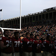Harvard players sing the National Anthem before the Harvard Vs Yale, College Football, Ivy League deciding game, Harvard Stadium, Boston, Massachusetts, USA. 22nd November 2014. Photo Tim Clayton