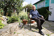 Jim in the garden of his prefab at the Excalibur estate in Catford, South London. He has been living in his prefab for 20 years and is fighting to save it as the Lewisham Council want to pull the prefabs down.