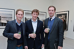Left to right, EARL PERCY, EDMUND SALVESEN and JJ JARDINE-PATERSON at a private view of photographs by wildlife photographer David Yarrow included in his book 'Encounter' held at The Saatchi Gallery, Duke of York's HQ, King's Road, London on 13th November 2013.