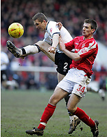 Photo: Paul Thomas. Nottingham Forest v Derby County. Forest Ground, Nottingham. Coca Cola Championship. 26/02/2005. Muhamed Konjic and Scott Dobie.