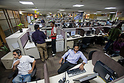 Shashi Kanth, a  call center worker, sits at his workstation at the AOL call center on the outskirts of Bangalore, India. (Shashi Kanth is featured in the book What I Eat: Around the World in 80 Diets.)