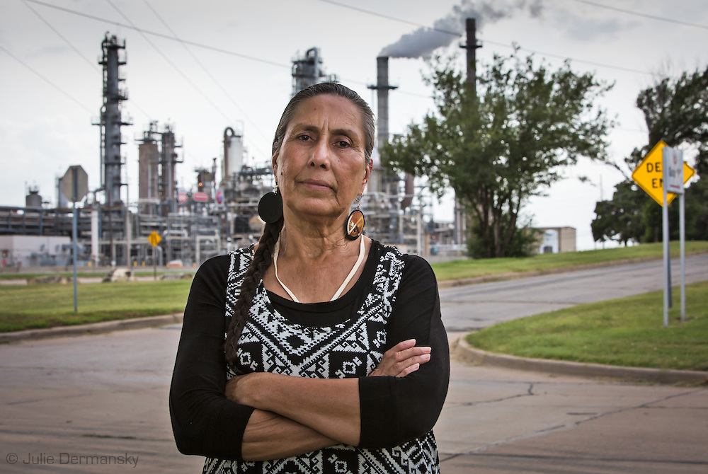 Casey Camp Horinek in Ponca City, Oklahoma across from a Conco Philips refinery.  Casey is a Native American, an elder in the Ponca tribe who has been fighting against industry for years. Landmen are leasing land where the Ponca live now for fracking. The area is plagued by earthquakes.