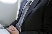 businessman reading newspaper during flight