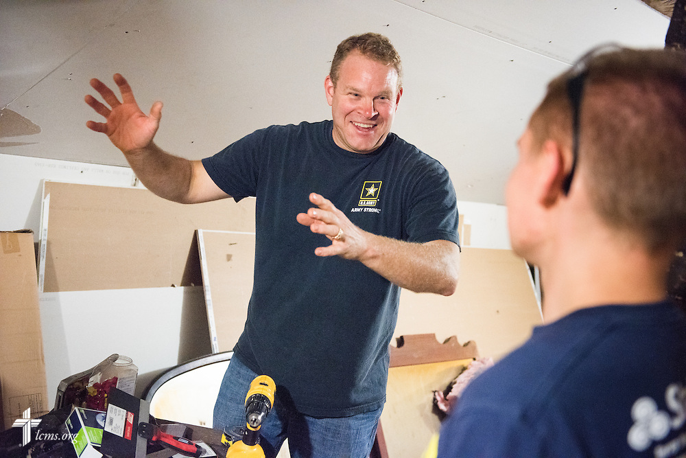 The Rev. Peter M. Burfeind, new domestic missionary and campus pastor at the University of Toledo, works with student Gunther Ruck as they rehab a home as part of their Engineers in Christ project work on Thursday, July 9, 2015, in Toledo, Ohio. LCMS Communications/Erik M. Lunsford