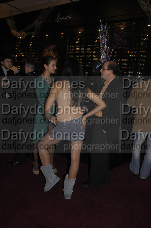 Padma Lashkmi and Salman Rushdie, Opening night of Dralion. Cirque de Soleil's 20th anniversary. Royal Albert Hall. 6 jan 2005. ONE TIME USE ONLY - DO NOT ARCHIVE  © Copyright Photograph by Dafydd Jones 66 Stockwell Park Rd. London SW9 0DA Tel 020 7733 0108 www.dafjones.com