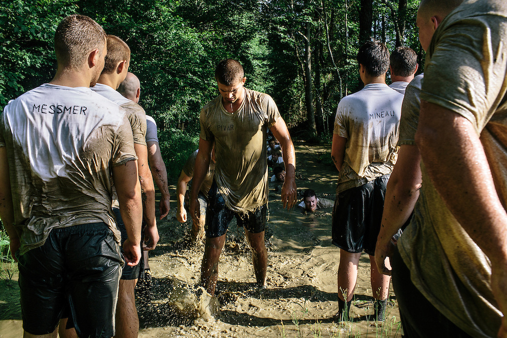 Participants in the Extreme SEAL Experience go through a series of physical exercises in the mud during the morning session of hell night.