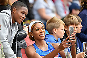 Raevyn Rogers (USA) poses for a selfie with a young fan during the Birmingham Grand Prix, Sunday, Aug 18, 2019, in Birmingham, United Kingdom. (Steve Flynn/Image of Sport via AP)