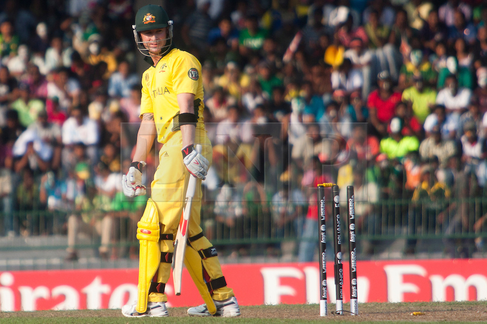 ©London News Pictures. 19/03/2011.Michael Clarke looks on at the stumps after getting bowled by Abdul Razzaq at R.Premadasa Stadium Colombo Sri Lanka