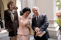 HONG KONG: Former Hong Kong Governor Chris Patten speaks with former Chief Secretary Anson Chan as Lavender Patten looks on in Central Hong Kong. Patten was the 28th and last  British Governor of Hong Kong from 1992 until the handover on July 1, 1997. During his 5 years in office his most controversial actions related to the election of the Hong Kong Legislative Council. Legco members returned in 1995 were originally to serve beyond the handover, thereby providing institutional continuity across the reversion of Hong Kong to China.  He was fairly popular as a governor and the people in Hong Kong affectionately nicknamed him Fat Pang or Fei Peng, making him the first and only governor to have a Chinese nickname. (Photo by David Paul Morris) ..