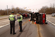 Ohio State Patrol troopers Frank Simmons (left) and David Griffith investigate an accident at the intersection of westbound US 35 and Trebein Road near Xenia, Saturday, March 26, 2011.