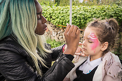 Homes for Haringey & Keepmoat Regeneration community event, London Borough of Haringey, London UK - facepainting