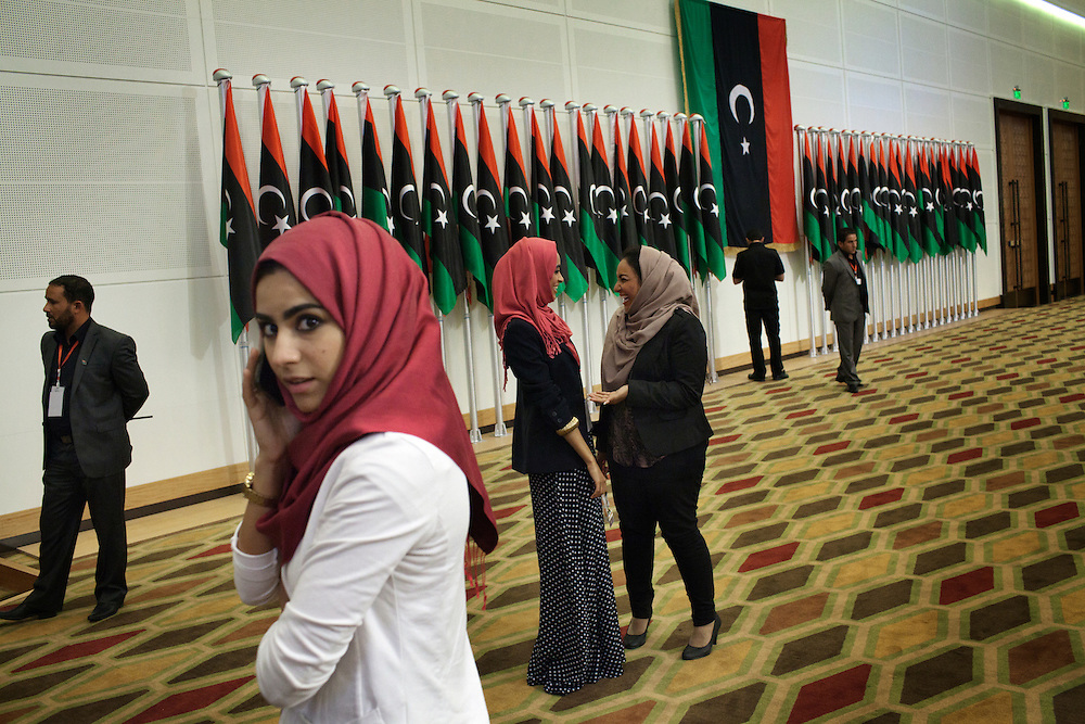 Libyan girls in the National Election Commission in Tripoli wait for the announcement of the official results of the first democratic elections in Libya.