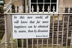 Sign with quote from Robert Owen at New Lanark UNESCO World Heritage site in Lanarkshire, Scotland, United Kingdom