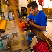 Teotitlán del Valle is a small village part of the Tlacolula Valley district. It is known for its textiles, especially rugs, which are woven on hand-operated looms, from wool obtained from local sheep and dyed mainly with local, natural dyes. They combine historical Zapotec designs with contemporary designs such as reproductions of famous artists' work.